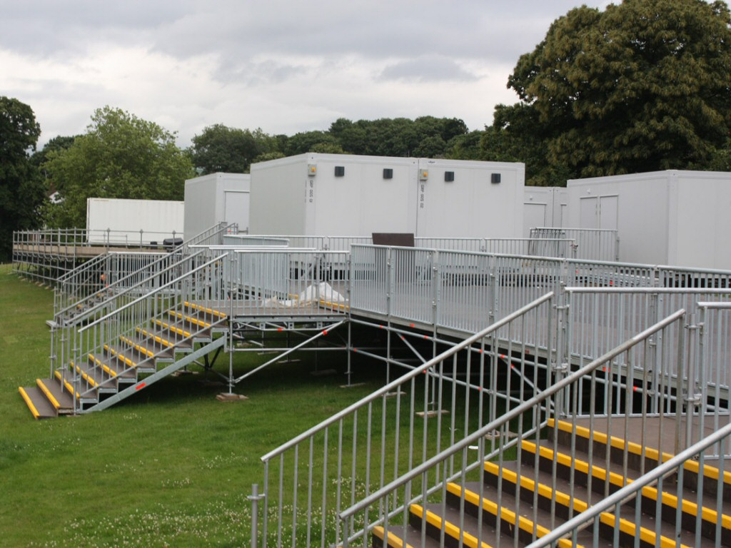 Temporary kitchens and food stores for the London Olympics with a raised platform to cope with a sloped location.